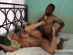 Alura Jenson jerks off a black rod with her feet