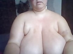MILF in glasses with phat natural boobies displaying