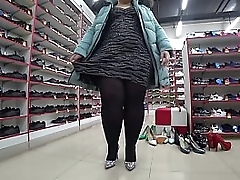 A chubby lady in a public upwards amass tries on shoes with the addition of shakes a fat butt under dress. Voyeurism.