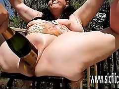 BBW double fisted and up to the eyes a giant bottle