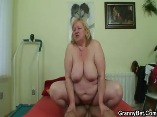 Huge granny swallows his scalding cock